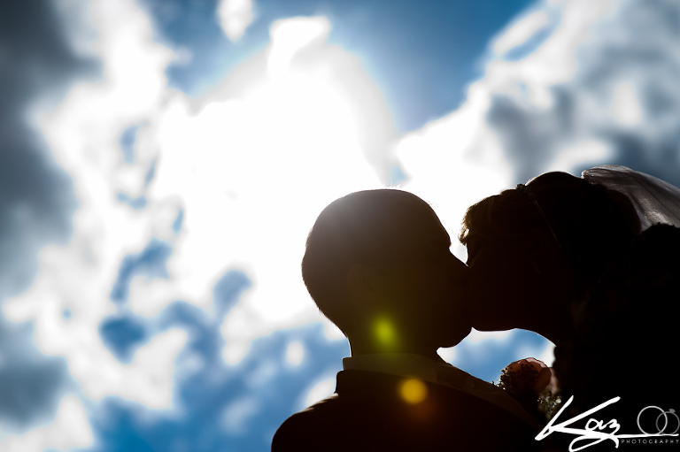 A kiss where they're silhoutted by the sun